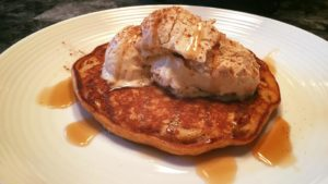 pumpkin pancake with salted caramel ice cream and maple syrup drizzle